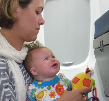 Should Parents Give Goody Bags and Apologies in Advance When Traveling With Babies?